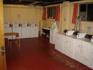 Laundry room with top loading washers and top loading dryers